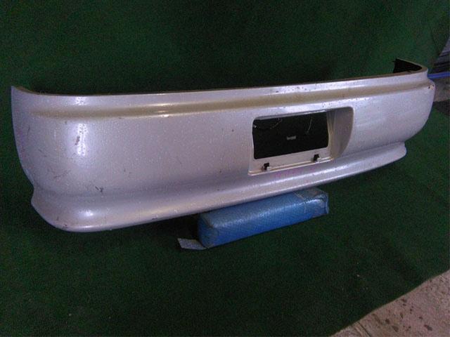 Бампер задний серый (лом креп, потерт) (Б/У) для TOYOTA MARK II X90 1992-1996