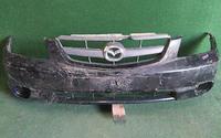 Бампер передний черный в сборе с решеткой радиатора и заглушкой ПТФ (царапины) MAZDA TRIBUTE