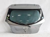 Крышка багажника серебро в сборе со стеклом, со спойлером (мятая) MAZDA DEMIO DE 2007,2008,2009,2010,2011,2012,2013,2014