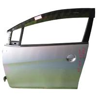 Дверь передняя левая серебро в сборе (вмятина) NISSAN MOCO I G21 2001,2002,2003,2004,2005,2006