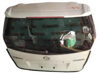 Крышка багажника белая в сборе со стеклом, со спойлером MAZDA PREMACY CP 1998,1999,2000,2001,2002,2003,2004,2005